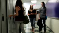 High School student walking down hall video