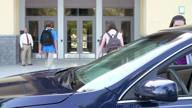 High School Students Being Dropped Off At School By Parents video