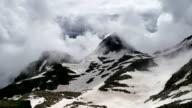 High Snowy Mountains and Frozen Lake Timelapse. Kavkaz region video