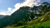 High Snowy Mountains and Green Hills, Clouds Timelapse. Kavkaz region video