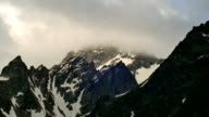 High Snowy Mountains with Clouds Evening Timelapse. Kavkaz region video