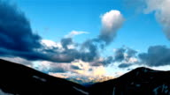 High Snowy Mountains with Clouds Sunset Timelapse. Kavkaz region video