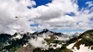 High Snowy Tops of Mountains with Clouds Timelapse. Kavkaz region video
