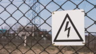 High - voltage substation. Warning sign of danger. Electric shock. Electrical supports, wires with insulators. Energy industry video