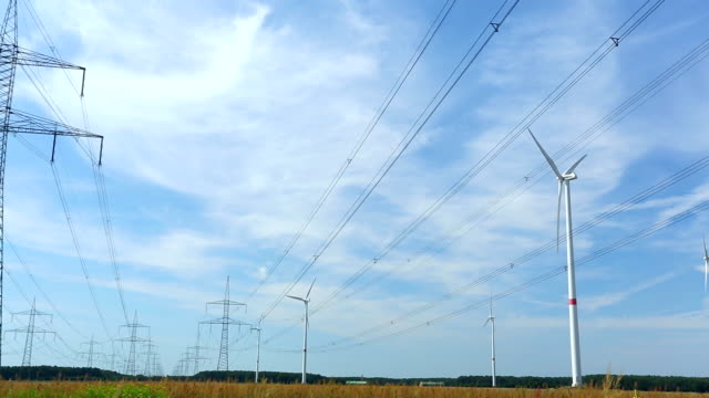 High Voltage Towers with wind turbines video