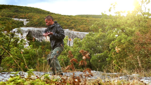 High-mountain training base camp: yoga trainer performs exercises having retired in the nature video