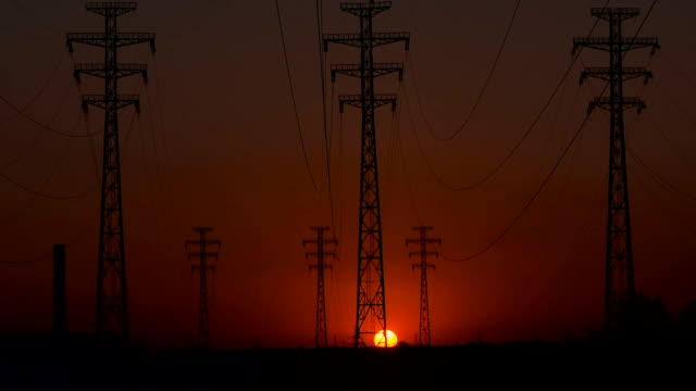 High-voltage power lines at sunrise. video