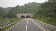 highway driving: across tunnel,on the road to Fenghuang,china. video