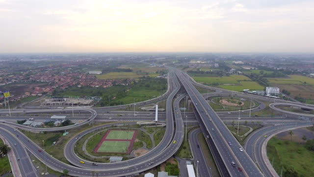 Highway traffic and circle in Bangkok Thailand, Aerial view video