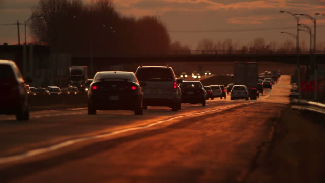 Highway traffic at sunset. video