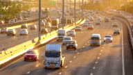 Highway traffic in evening and sunlight video