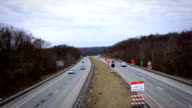 Highway Traffic near construction zone - overpass angle video