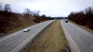 Highway Traffic on overcast day - overpass angle video