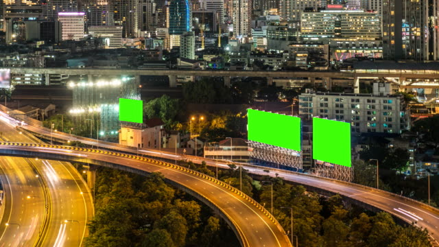 Highway with Billboard chroma key and Cityscape at night video