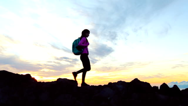 Hike. woman hiker walking. Hiking girl walking alone in beautiful landscape nature at sunset video