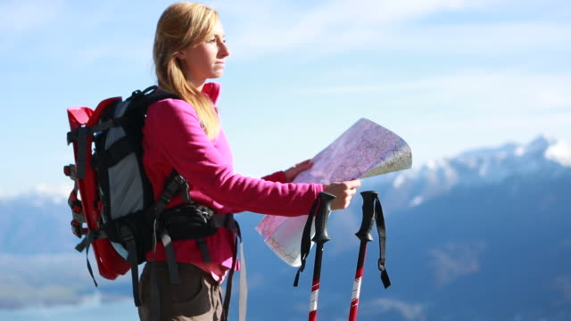 Hiker checking map from look out point video