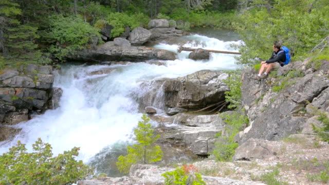 Hiker Enjoys Scenic Waterfall video