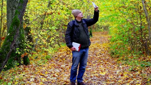 Hiker filmed with tablet PC in the park video