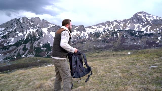Hiker going along grassy slope video