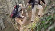 Hiker helping woman video