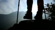 hiker legs on mountain peak rock video