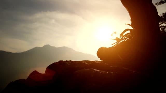 hiker legs on mountain peak rock video