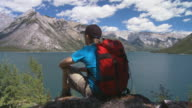 Hiker looks over lake 2 video
