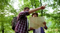 Hiker making a plan with a hiking map in forest video