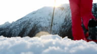 Hiker reache top of mountain, outstretches arms video