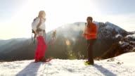 Hiker reaches mountain top, high five to companion video