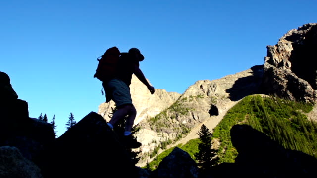 Hiker silhouetted against mountians video