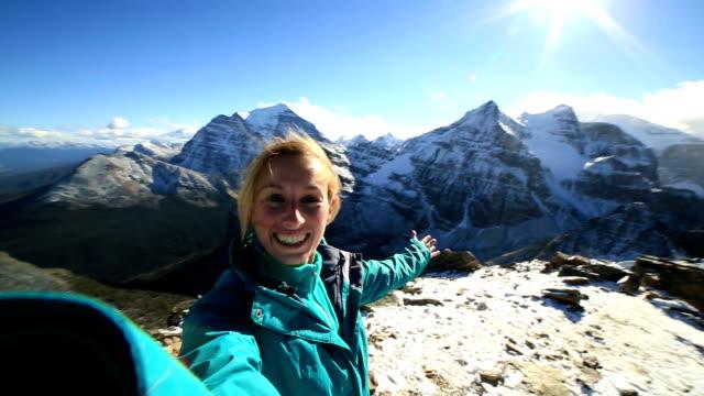 Hiker takes 360 degree selfie on mountain peak video
