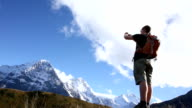 Hiker takes picture below Eiger, North Face video
