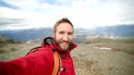 hiker takes selfie portrait video