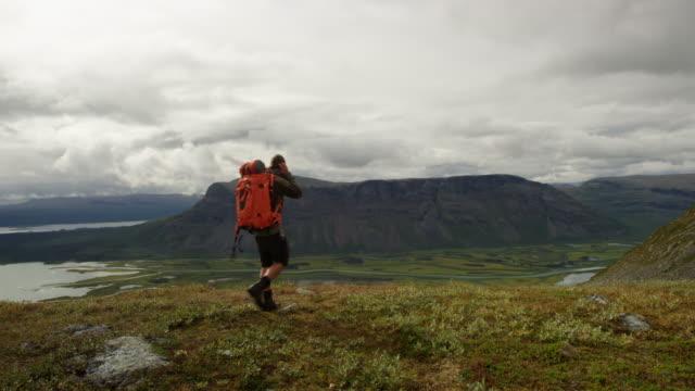 Hiker walking in Rapadalen video