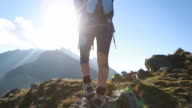 Hiker walks along narrow summit ridge crest video