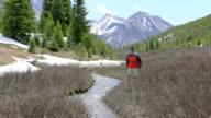 Hiker walks in a mountainous region video