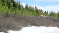 Hiker walks in a moutainous region video