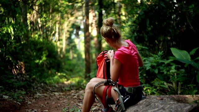 Hiker woman having a rest-Forest video