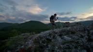 Hiker woman is walking mountain, video