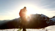 Hikers celebrating on top of mountain at sunset video