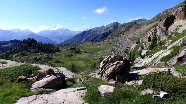hiking, walking, trekking outdoors on mountain video