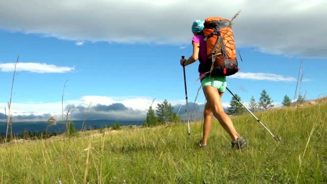 Hiking woman tourist is walking mountain range video