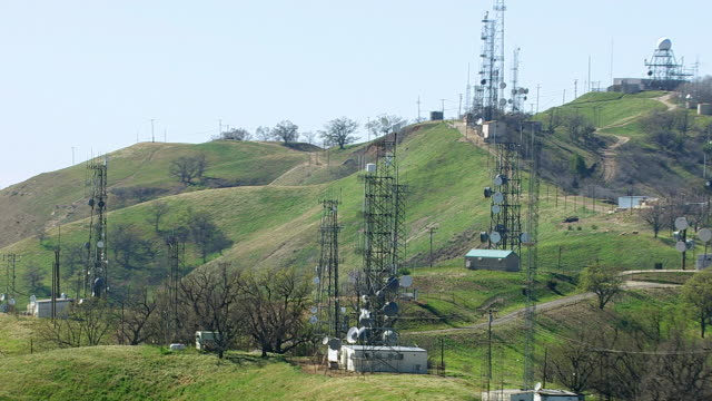 Hillside covered in cell phone towers, California video