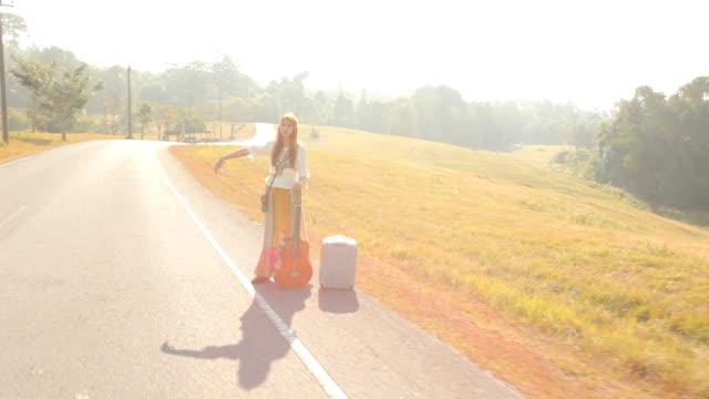Hippie girl hitchhiking video