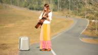 Hippie woman playing music and dancing video