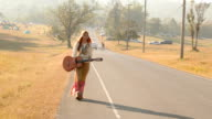 Hippie woman walking on the road video