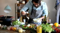 Hipster adds dressing to the salad video