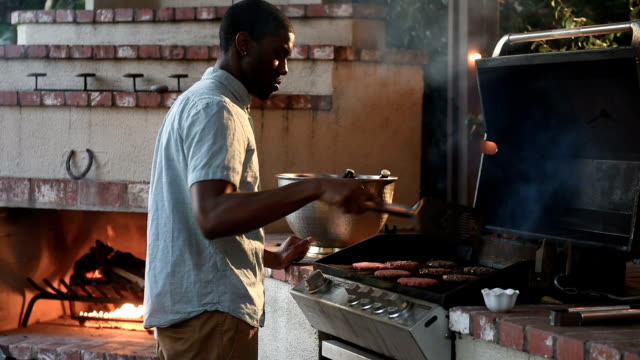 Hipster Black Male Grills at Backyard Summer BBQ video