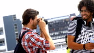 Hipster boy taking his friends in picture video